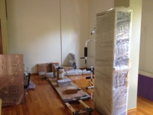 Preparing to unpack the IDD Therapy machine, freshly arrived by sea