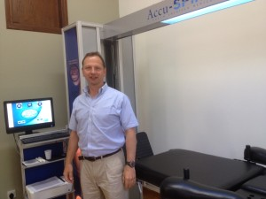Stephen Small with the IDD Therapy licensed Accu SPINA at Nicky Stavrou Physiotherapy Cyprus